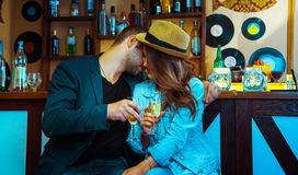 Woman seducing a man in a bar and drinking champagne Royalty Free Stock Images