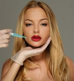 Woman with seductive lips with syringe Royalty Free Stock Photography