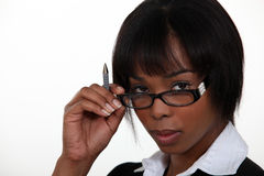 Woman seductively removing glasses Royalty Free Stock Photography