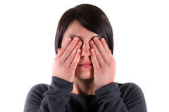 Woman with the see no evil gesture. On white background Royalty Free Stock Image