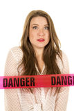 Woman see through shirt red bra danger shock. A woman with a shocked expression on her face with danger tape stock images