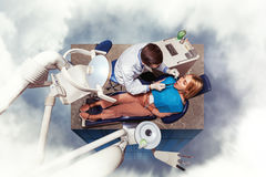 Woman seeing a dentist Stock Images