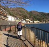 A woman seeing landscape of Kawaguchi lake in Saitama, Japan.  royalty free stock image