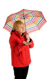 Woman seeing whether it rains Stock Images
