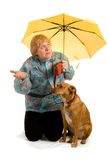 Woman seeing whether it rains Stock Photo