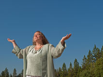 Woman seeking blessing Royalty Free Stock Image