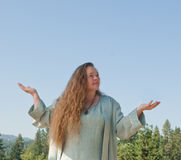 Woman seeking blessing Royalty Free Stock Photography