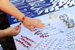 Woman seeking a bracelet. At the weekly market you can buy jewelry Royalty Free Stock Images