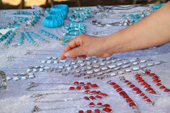 Woman seeking a bracelet. At the weekly market you can buy jewelry Royalty Free Stock Photo