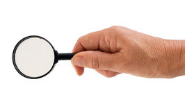 Woman seeking solution - hand with magnifying glass isolated Royalty Free Stock Image