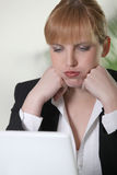Woman seems exasperated. Woman exasperated with her laptop stock photography