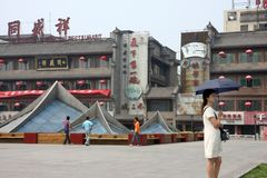 China Travel. A woman is seen with a parasol in Xi` An, China Royalty Free Stock Image