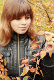 Woman sees autumn leaves Stock Photography