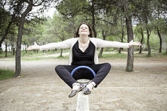 Woman in seesaw Royalty Free Stock Photography