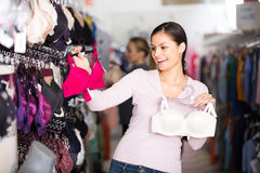 Woman selecting bra in lingerie store Royalty Free Stock Photo