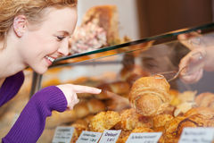 Woman Selecting Bread From Display Cabinet Stock Photos
