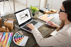 Woman Selecting Color For The Kitchen Room. An Female Architect Working On Color Selection For The Kitchen Drawing On Laptop Screen Royalty Free Stock Image