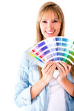 Woman selecting a color to paint Royalty Free Stock Photography