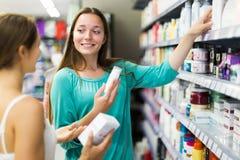 Woman selecting cosmetical cream Stock Photos