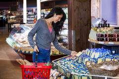 Woman selecting dairy products in grocery section Stock Images