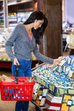 Woman selecting dairy products in grocery section Royalty Free Stock Images
