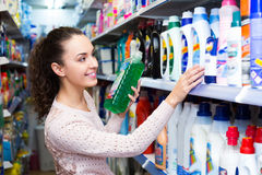 Woman selecting fabric conditioner Royalty Free Stock Photography