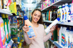 Woman selecting fabric conditioner Royalty Free Stock Photos
