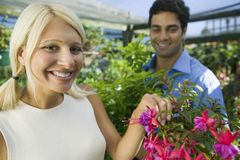 Woman selecting Flowers in plant nursery portrait Royalty Free Stock Photos