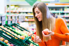 Woman selecting fruits in supemarket Royalty Free Stock Image
