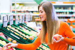 Woman selecting fruits in supemarket Royalty Free Stock Photography