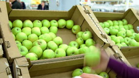 Woman selecting green apples in the grocery stock video footage