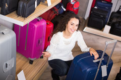 Woman selecting handy trunk in store Stock Photo