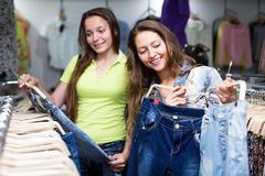 Woman selecting jeans Royalty Free Stock Photo