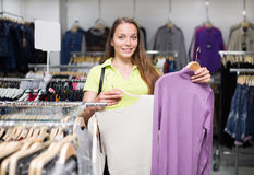 Woman selecting jersey Royalty Free Stock Images