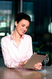 Woman selecting menu on digital tablet Royalty Free Stock Photo