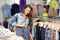 Woman selecting pants Stock Image