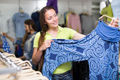 Woman selecting pants Royalty Free Stock Photography