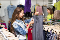 Woman selecting pants Royalty Free Stock Images