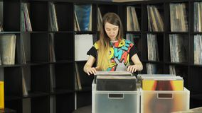 Woman selecting records at a record shop.  stock video footage