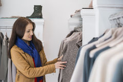 Woman selecting sweater in store Royalty Free Stock Image