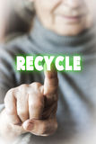Woman selecting to recycle Royalty Free Stock Images