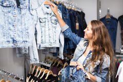 Woman selecting waistcoat Royalty Free Stock Photography