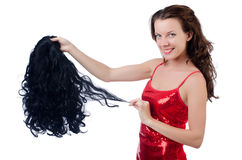 Woman with a selection of wig stock photo