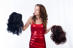 Woman with a selection of wig royalty free stock images