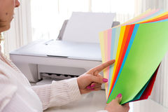 Woman selects color of paper. Stock Image