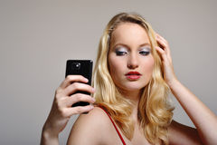 Woman selfie. Blonde long haired caucasian female is posing for her selfie Royalty Free Stock Image