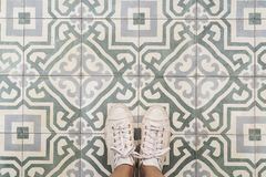 Woman selfie of feet with shoes on the retro seamless floor Stock Images