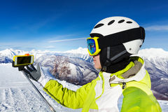 Woman with selfie stick on the mountain Royalty Free Stock Image