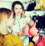Woman seller assisting woman in choosing bra Stock Photography