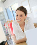 Woman seller in a clothing shop Stock Image